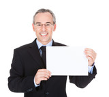 Businessman With Blank Card