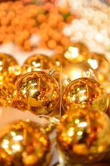 Shiny golden Christmas bulbs
