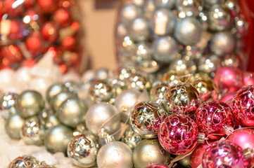 Glittering silver and pink Christmas baubles