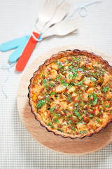 Quiche with chicken and vegetables, selective focus
