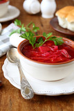 Traditional Ukrainian borsch with donuts