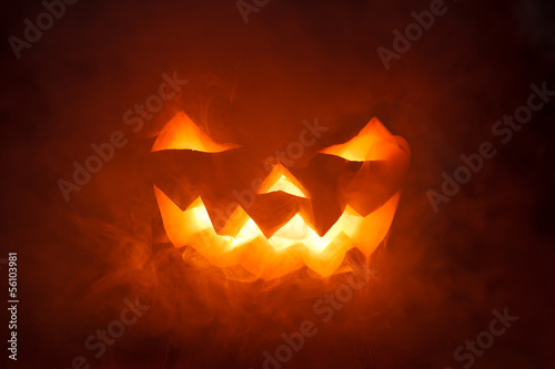 Scary Halloween Pumpkin looking through the smoke