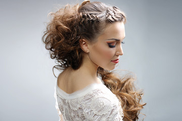 Beautiful woman with curly hairstyle