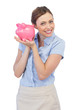 Cheerful businesswoman holding piggy bank