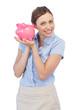 Cheerful businesswoman holding piggy bank