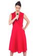 Serious elegant brunette in red dress singing