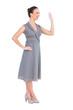 Happy elegant woman in classy dress waving