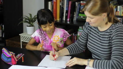 Homeschool Mom Marking Test With Daughter