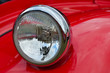 Detail of red headlamp on classic car