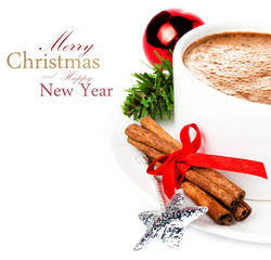 Christmas card with hot cup of cappuccino,  cinnamon sticks and