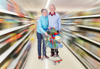 Senior Couple With A Shopping Cart
