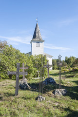 Graveyard crosses and white church