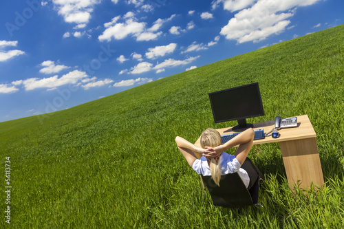 Business Woman Relaxing at Desk in Green Field Office