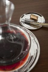 Corkscrew and red wine in decanter