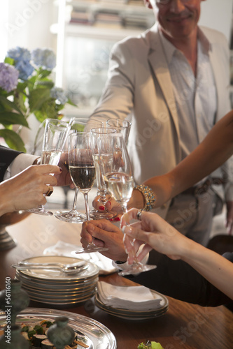 Hands of people toasting in party
