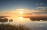 Fototapety Golden sunrise at river