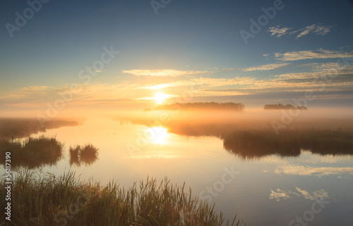 Golden sunrise at river