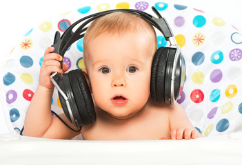 happy baby with headphones listening to music