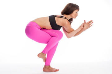Pretty Woman in Yoga Pose - Eagle Pose Position.