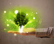 Glowing tree growing in the hand of a businessman