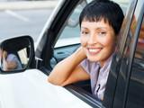 Smiling senior woman in a car