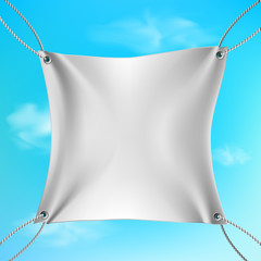 White banner stretched out on the ropes against the blue sky