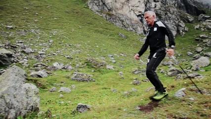 fit man doing nordic walking