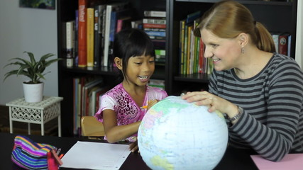 Homeschool Mom Teaching Geography Lesson To Daughter