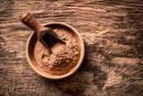 Bowl of ground cinnamon powder