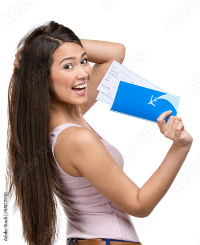 Half-length portrait of female tourist handing airline ticket
