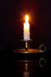 Candle in brass chamberstick