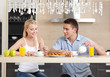 Couple has a snack in the modern comfortable kitchen