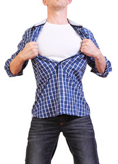 Superhero. Image of young man tearing his shirt off isolated on
