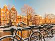Leinwandbild Motiv Bicycles covered with snow during winter in Amsterdam