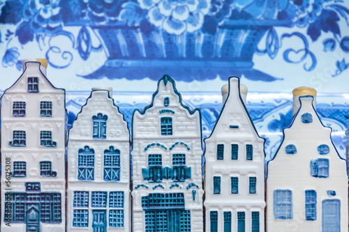Deurstickers Amsterdam Dutch Delft blue souvenir houses in front of an old plate