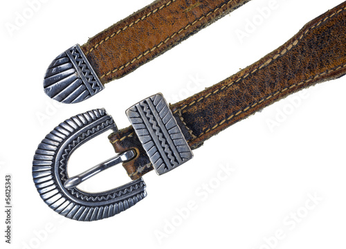 Silver buckle on leather belt