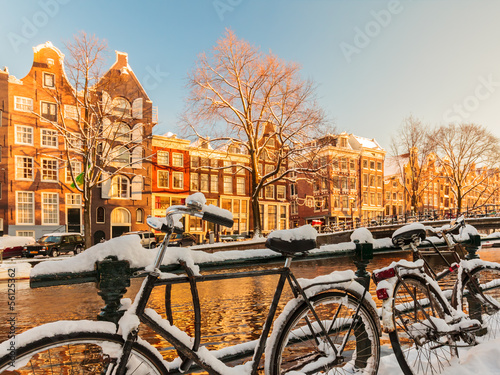 Canvas Amsterdam Bicycles covered with snow during winter in Amsterdam