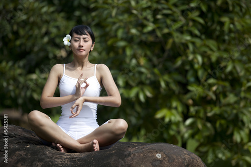 Asian woman meditating for yoga outside