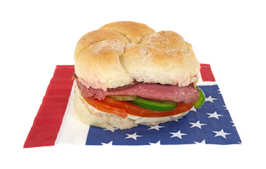 Roast beef sandwich on patriotic napkin