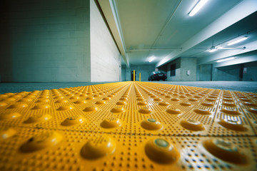 Industrial room garage interior with yellow bumps