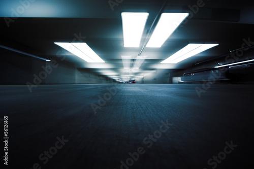 Fotobehang Industrial geb. Dark parking garage industrial room interior. Zoom blur.