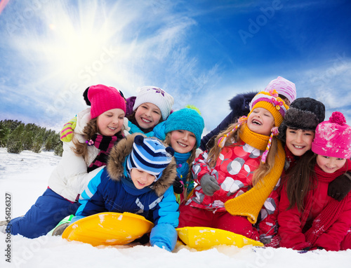 Group of happy kids outside at winter