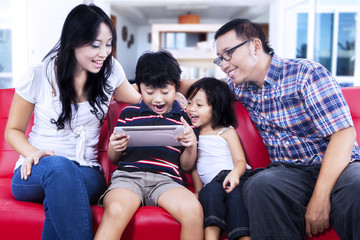 Family using digital tablet browsing the internet