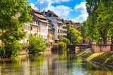 Fototapety Strasbourg, water canal in Petite France, Unesco site. Alsace.