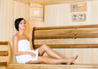 Half-naked woman relaxing in sauna