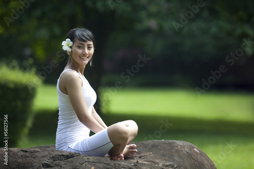 Young Asian Woman Smiling in Yoga Position