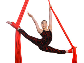 acrobatic gymnastic girl exercising on fabric rope