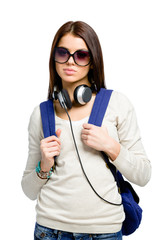 Teenager with knapsack and earphones wearing black sunglasses