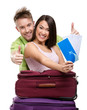 Couple with suitcases and tickets, isolated on white