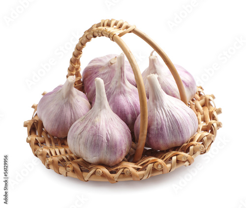 Fresh garlic in a wicker basket